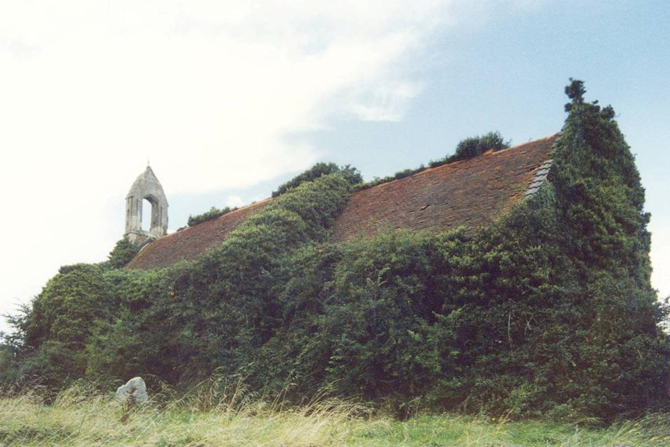 St Denis Church East Hatley hidden in ivy. (SWNS)