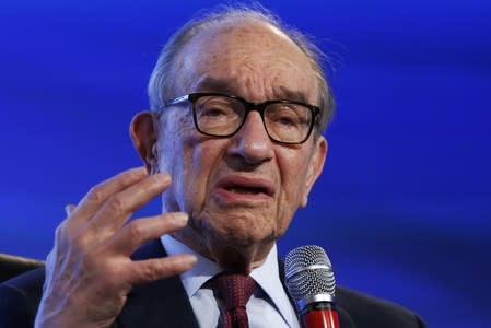 FILE PHOTO: Former U.S. Federal Reserve Chairman Alan Greenspan speaks during an onstage interview at the 2014 Peterson Foundation Fiscal Summit in Washington