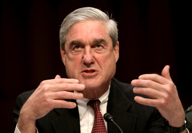 FILE PHOTO - Then FBI Director Robert Mueller testifies at a Senate Intelligence Committee hearing on Capitol Hill in Washington, DC, U.S. on February 16, 2011. REUTERS/Jason Reed/File Photo