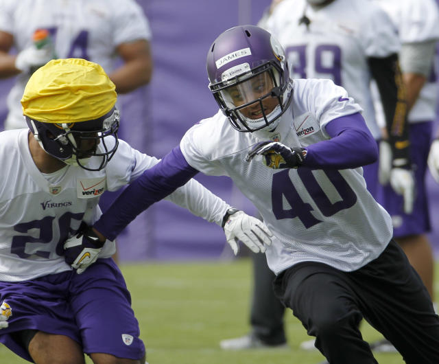 Defensive back Kendall James (40) takes part in a drill during Minnesota Vikings mini camp in Eden Prairie, Minn., Friday, May 16, 2014. New Vikings coach Mike Zimmer set to work getting young players like quarterback Teddy Bridgewater, linebacker Anthony Barr and defensive backs Antone Exum and James up to speed on what will be expected of them in the NFL. (AP Photo/Ann Heisenfelt)