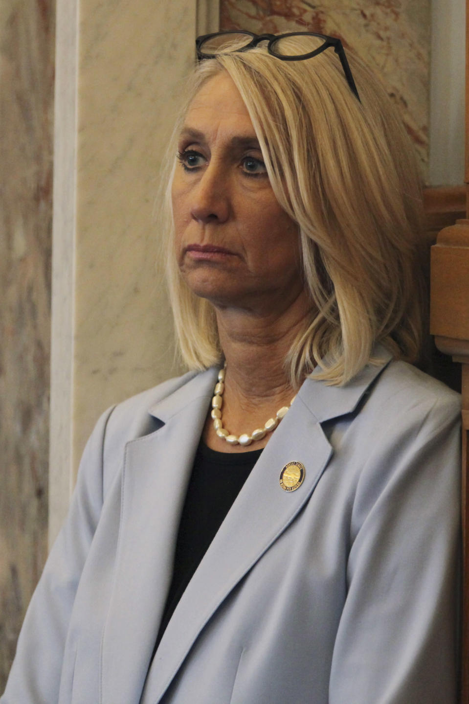 Kansas state Sen. Renee Erickson, R-Wichita, watches a debate in the House from the side of the chamber, Thursday, April 8, 2021, at the Statehouse in Topeka, Kan. Erickson is the primary sponsor of a proposal to ban transgender athletes from girls' and women's school sports, arguing that such a measure would protect the fairness of competition. (AP Photo/John Hanna)