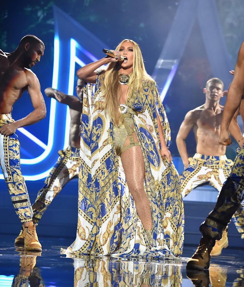 "<p>The star opened her performance of her greatest hits wearing a flowing gold and blue printed Versace silk cape, performing ""Waiting For Tonight"" for an adoring audience. </p>"