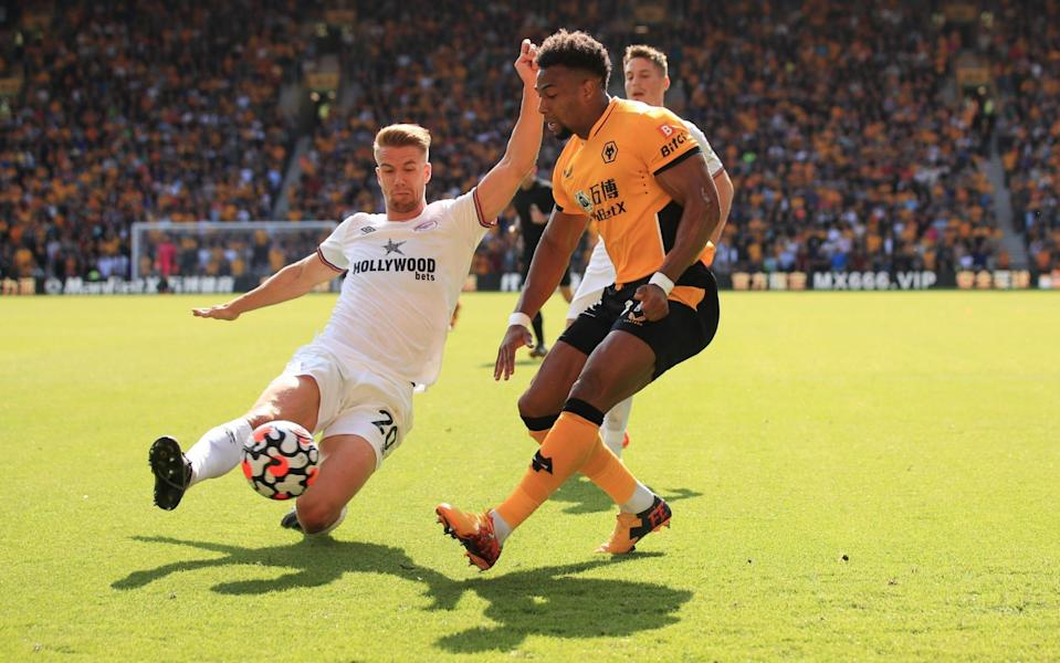 Adama Traore of Wolverhampton Wanderers in action with Kristoffer Ajer of Brentford. - Marc Atkins/Getty Images