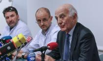 Jean-Francois Payen (C), head anaesthetician at the CHU hospital, neurosurgeon Stephan Chabardes (L) and Professor Gerard Saillant (R), President of the Institute for Brain and Spinal Cord Disorders (ICM), attend a news conference at the CHU Nord hospital emergency unit in Grenoble, French Alps, where retired seven-times Formula One world champion Michael Schumacher is hospitalized after a ski accident, December 30, 2013. Former Formula One champion Michael Schumacher was battling for his life in hospital on Monday after a ski injury, doctors said, adding it was too early to say whether he would pull through. Schumacher was admitted to hospital on Sunday suffering head injuries in an off-piste skiing accident in the French Alps resort of Meribel. (REUTERS/Robert Pratta)