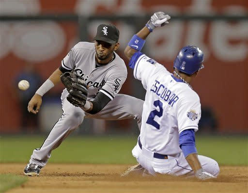 Kansas City Royals' Alcides Escobar beats the tag by Chicago White Sox shortstop Alexei Ramirez to steal second base during the fifth inning of a baseball game Wednesday, Sept. 19, 2012, in Kansas City, Mo. (AP Photo/Charlie Riedel)