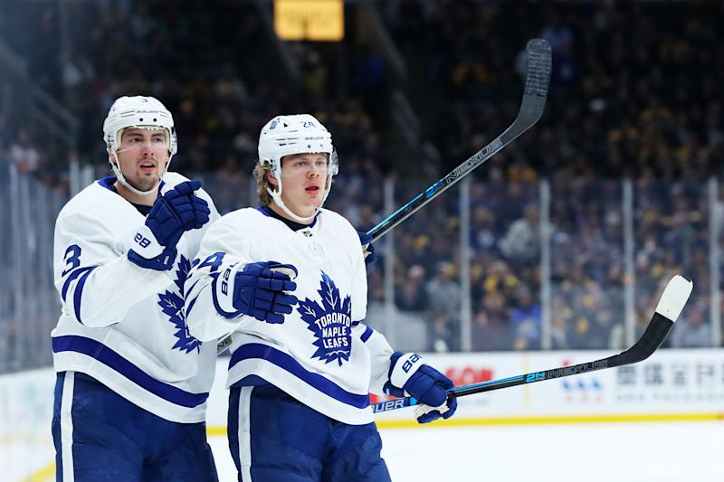 BOSTON, MASSACHUSETTS - OCTOBER 22: Kasperi Kapanen #24 of the Toronto Maple Leafs celebrates with Justin Holl #3 after scoring a goal against the Boston Bruins during the second period at TD Garden on October 22, 2019 in Boston, Massachusetts. (Photo by Maddie Meyer/Getty Images)