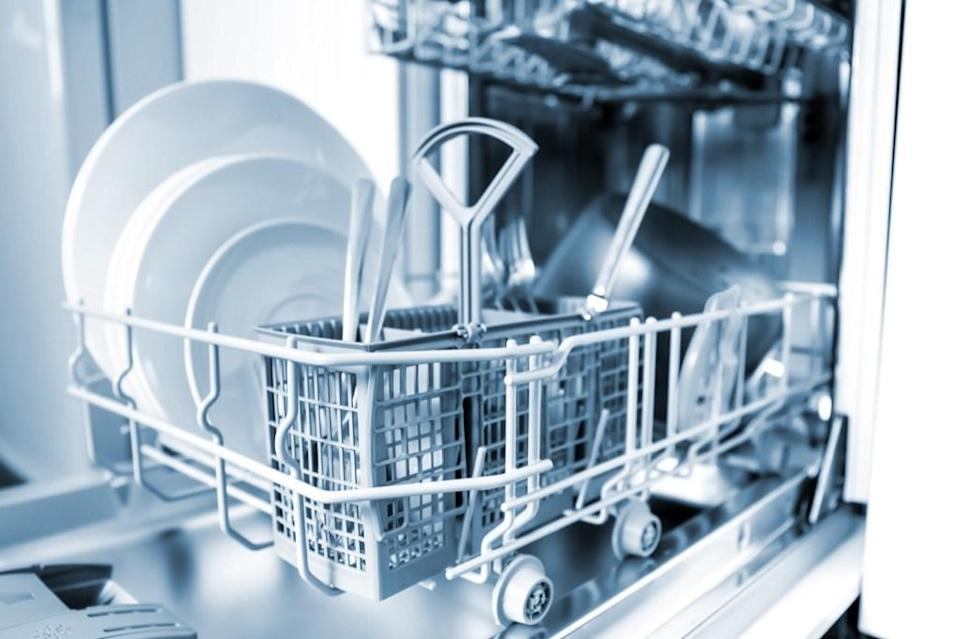 """Your dishwasher is not meant to handle everything and anything either. Loading the appliance up with items it's not meant to wash can cause major problems. As <a href=""""https://www.consumerreports.org/dishwashers/things-to-never-put-in-dishwasher/"""" rel=""""nofollow noopener"""" target=""""_blank"""" data-ylk=""""slk:Consumer Reports"""" class=""""link rapid-noclick-resp""""><em>Consumer Reports</em></a> notes, you should never stick cast-iron cookware, sharp knives, or wooden utensils in the dishwasher. Also, if you're the type to cook salmon in the dishwasher (yes, that's a thing!), reconsider. Most dishwasher manufacturers don't test their appliances for cooking capabilities."""