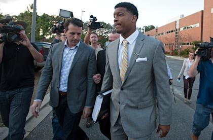 Jameis Winston leaves his student conduct code hearing on Tuesday. (Getty)