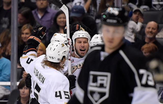Anaheim Ducks center Ryan Getzlaf, third from left, celebrates his goal with teammates as Los Angeles Kings center Tyler Toffoli, right, looks on during the first period in Game 4 of an NHL hockey second-round Stanley Cup playoff series, Saturday, May 10, 2014, in Los Angeles. (AP Photo/Mark J. Terrill)