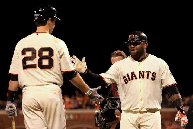 SAN FRANCISCO, CA - OCTOBER 24: Pablo Sandoval #48 of the San Francisco Giants celebrates with teammate Buster Posey #28 after hitting a solo home run to center field against Al Alburquerque #62 of the Detroit Tigers in the fifth inning during Game One of the Major League Baseball World Series at AT&T Park on October 24, 2012 in San Francisco, California. (Photo by Doug Pensinger/Getty Images)