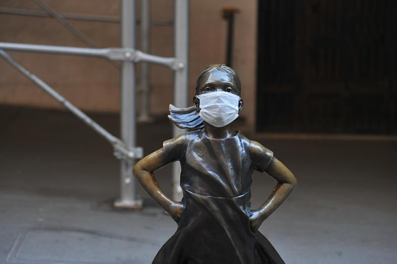The 'Fearless Girl' statue was photographed wearing a face mask. (Photo: Luiz Roberto Lima-ANB/Pacific Press/LightRocket via Getty Images)