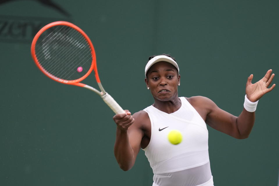 Sloane Stephens of the US plays a return to Kristie Ahn of the US during the women's singles second round match on day three of the Wimbledon Tennis Championships in London, Wednesday June 30, 2021. (AP Photo/Kirsty Wigglesworth)