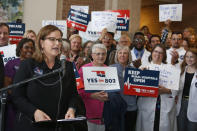 """FILE - In this Thursday, Oct. 24, 2019, file photo, Amber England, who headed the campaign to put Medicaid expansion on the ballot in Oklahoma, speaks before supporters of """"Yes on 802 Oklahomans Decide Healthcare,"""" deliver petitions to the Oklahoma Secretary of State's office, in Oklahoma City. The much-anticipated Medicaid expansion is coming to Oklahoma in 2021 after years of resistance from Republicans in the Legislature and governor's office. (AP Photo/Sue Ogrocki, File)"""