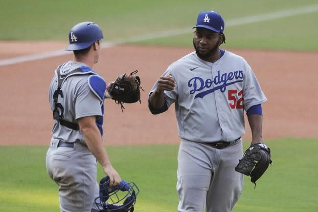 Dodgers beat Padres, become 1st to clinch post-season berth