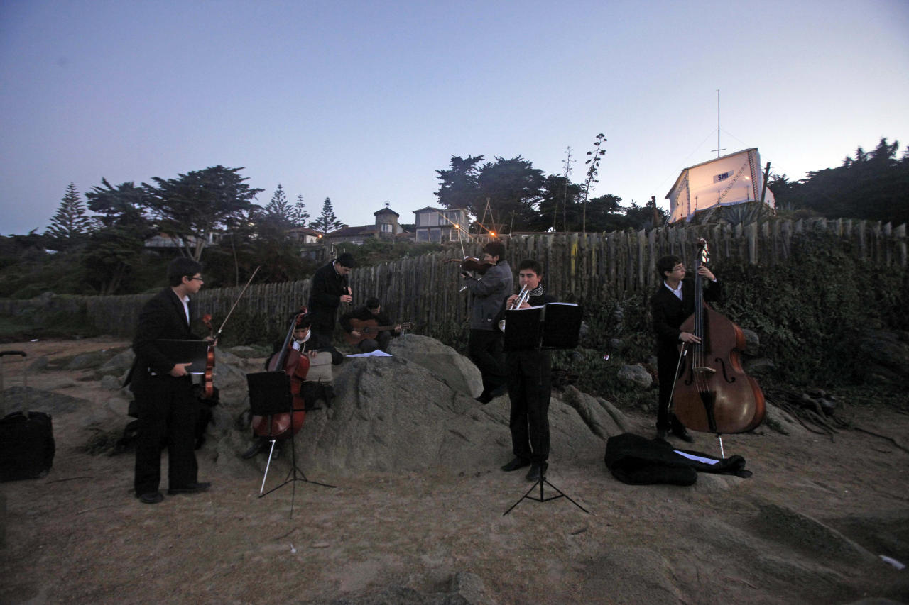 A band plays music near the tomb of Pablo Neruda on Isla Negra, Chile, Monday, April 8, 2013. Chilean forensic experts exhumed the body of Nobel laureate Pablo Neruda on Monday, trying to solve a four-decade mystery about the death of one the greatest poets of the 20th century. (AP Photo /Luis Hidalgo)