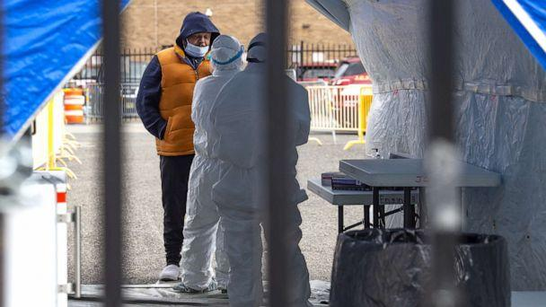 PHOTO: A man is tested by a doctor in protective gear at The Covid-19 testing site on Marin Boulevard in Jersey City, New Jersey, April 2, 2020. (Kostas Lymperopoulos/CSM/REX via Shutterstock)