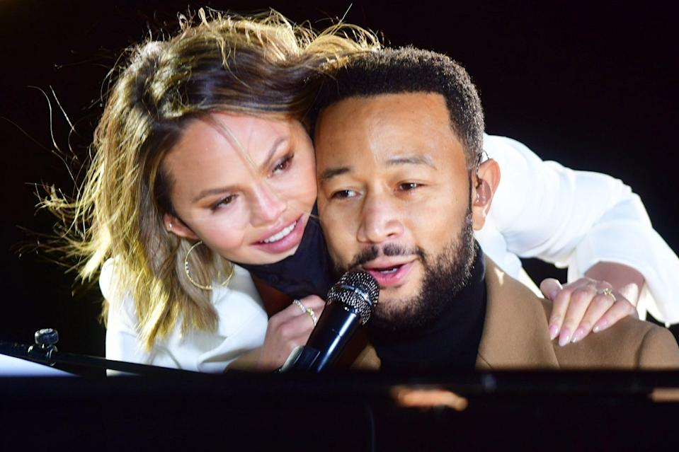 <p>Chrissy Teigen and John Legend cuddle up while making an appearance in support of the Biden/Harris campaign in Philadelphia.</p>
