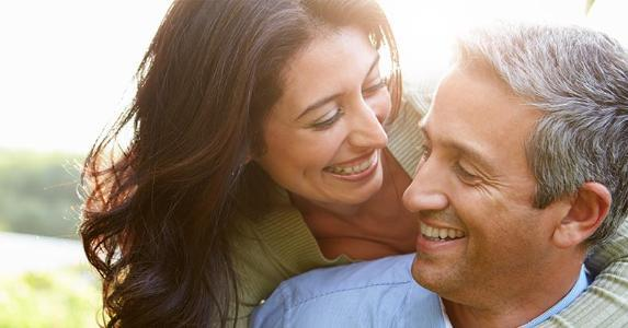 Closeup of smiling couple in their 40s copyright Monkey Business Images/Shutterstock.com
