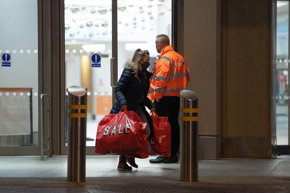 A woman leaves a shop in Nottingham (Getty)