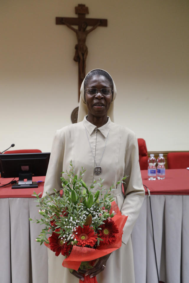 Togolese Sister Makamatine Lembo poses for photos after she successfully defended her dissertation on the sexual abuse of religious sisters by priests, at the Pontifical Gregorian University, in Rome, Thursday, Sept. 26, 2019. Sister Lembo was awarded summa cum laude, and was praised by her examiners for her courage in examining such a taboo subject. (AP Photo/Gregorio Borgia)