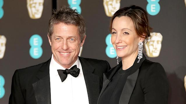 Hugh Grant and Anna Eberstein on the red carpet at the British Academy Film Awards, Feb. 18. (Photo: Mike Marsland/Mike Marsland/WireImage)