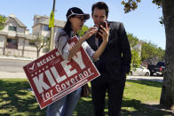 Assemblyman Kevin Kiley, right, of Rocklin, a Republican candidate for governor in the Sept. 14 recall election, speaks with supporter Nancy Jiang during a campaign stop outside of Manual Arts High School, Monday, Sept. 13, 2021, in Los Angeles. (AP Photo/Marcio Jose Sanchez)