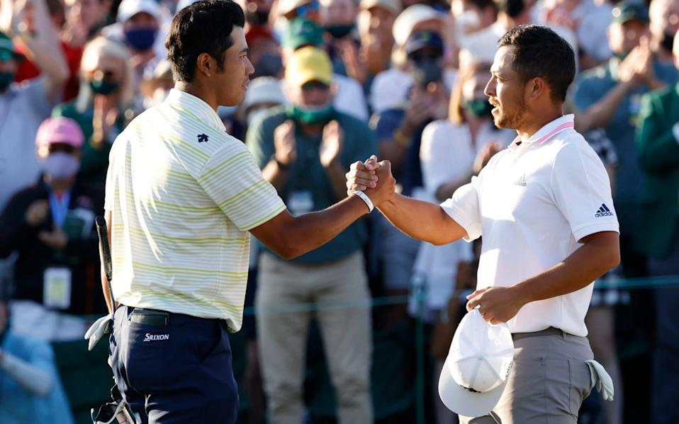 Japan's Hideki Matsuyama shakes hands with Xander Schauffele of the U.S. on the 18th green after winning The Masters  - Reuters