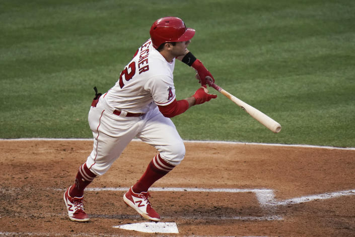 Los Angeles Angels' David Fletcher watches after hitting a two-run single during the second inning of a baseball game against the Los Angeles Dodgers, Friday, May 7, 2021, in Anaheim, Calif. (AP Photo/Jae C. Hong)