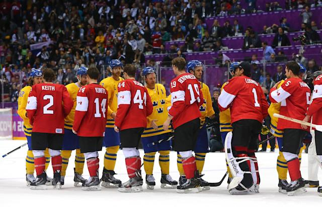 SOCHI, RUSSIA - FEBRUARY 23: Canada players shake hands with the Sweden team following their 3-0 victory during the Men's Ice Hockey Gold Medal match on Day 16 of the 2014 Sochi Winter Olympics at Bolshoy Ice Dome on February 23, 2014 in Sochi, Russia. (Photo by Martin Rose/Getty Images)