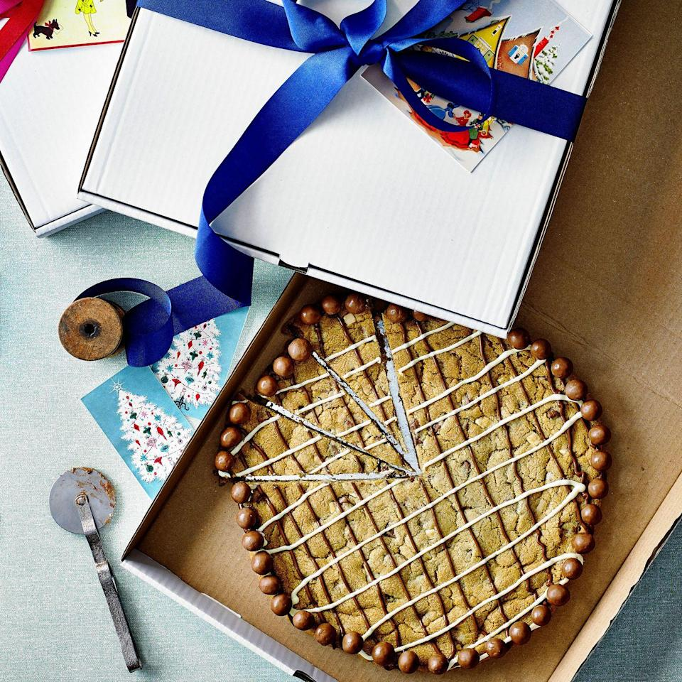 """<p>This also makes for a fun pudding served warm in slices topped with vanilla ice cream.</p><p><strong>Recipe: <a href=""""https://www.goodhousekeeping.com/uk/christmas/christmas-recipes/a34770067/chocolate-chip-cookie-pizza/"""" rel=""""nofollow noopener"""" target=""""_blank"""" data-ylk=""""slk:Chocolate Chip Cookie Pizza"""" class=""""link rapid-noclick-resp"""">Chocolate Chip Cookie Pizza</a></strong></p>"""