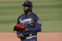 Atlanta Braves starting pitcher Touki Toussaint exhales in the third inning during a spring training baseball game against the Boston Red Sox on Monday, March 1, 2021, in Fort Myers, Fla. (AP Photo/Brynn Anderson)