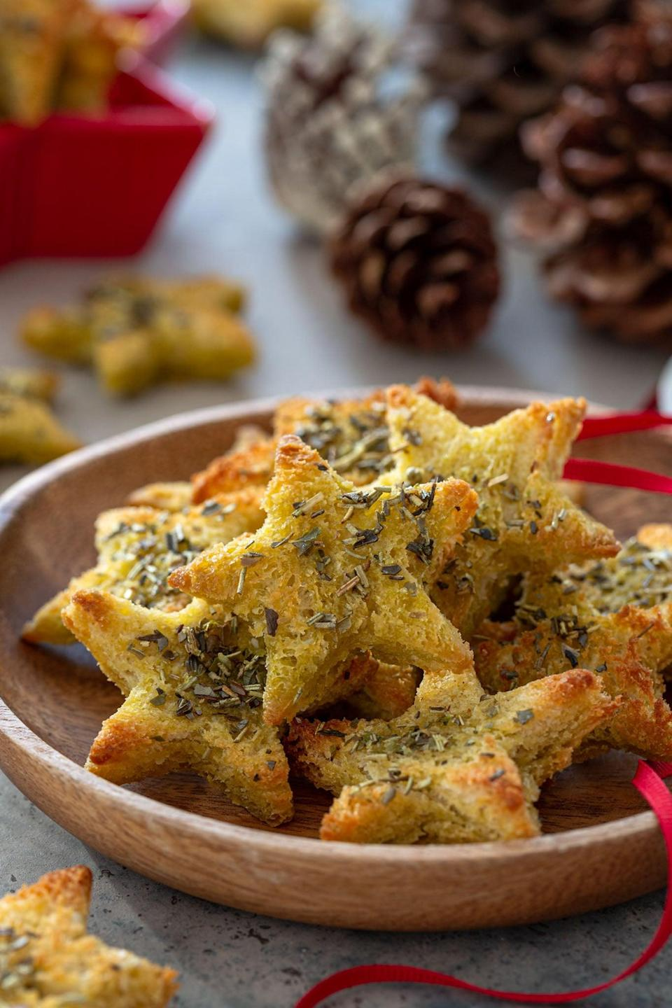 """<p>Whether you want to upgrade your cheese board or make your finger foods look even more delightful, these easy-to-make chips will do the trick. Just dust some bread with olive oil, herbs, and salt, and your work is just about done!</p> <p><strong>Get the recipe</strong>: <a href=""""https://www.oliviascuisine.com/star-bread-chips/"""" class=""""link rapid-noclick-resp"""" rel=""""nofollow noopener"""" target=""""_blank"""" data-ylk=""""slk:star bread chips"""">star bread chips</a></p>"""