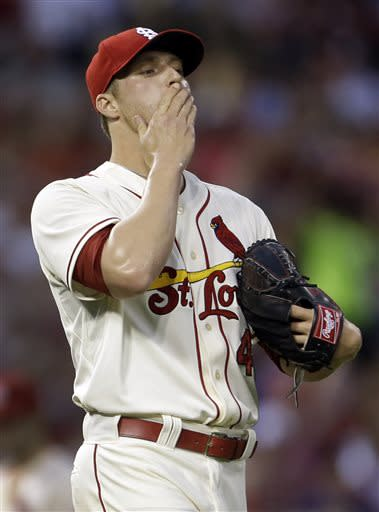 St. Louis Cardinals starting pitcher Shelby Miller reacts after Texas Rangers' Elvis Andrus was ruled safe at first during the third inning of a baseball game on Saturday, June 22, 2013, in St. Louis. (AP Photo/Jeff Roberson)