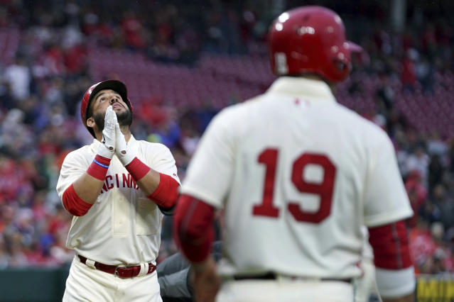 Cincinnati Reds' Eugenio Suarez reacts to hitting a three-run home run during the second inning of the team's baseball game against the San Francisco Giants, Saturday, May 4, 2019, in Cincinnati. (AP Photo/Aaron Doster)