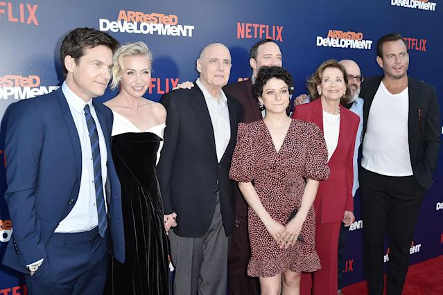 Reassuring hands: Portia de Rossi holds Jeffrey Tambor's hand and Tony Hale rests his hand on his co-star's shoulder at  the premiere of Netflix's <em>Arrested Development</em> Season 5 on May 17. (Photo:  Gabriel Olsen/WireImage)