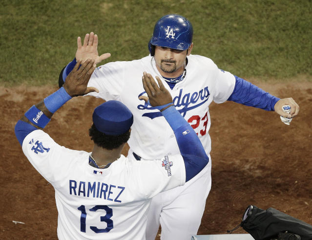 Los Angeles Dodgers' Adrian Gonzalez (23) is congratulated by Hanley Ramirez after scoring during the fourth inning of Game 3 of the National League baseball championship series against the St. Louis Cardinals Monday, Oct. 14, 2013, in Los Angeles. (AP Photo/Jae C. Hong)