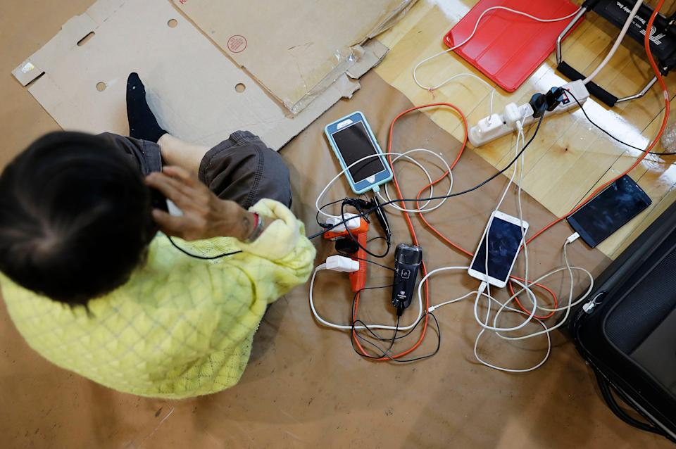 Cell phones and an electric shaver belonging to evacuees are charged at a shelter at Florida International University ahead of Hurricane Irma in Miami, Saturday, Sept. 9, 2017. (AP Photo/David Goldman)