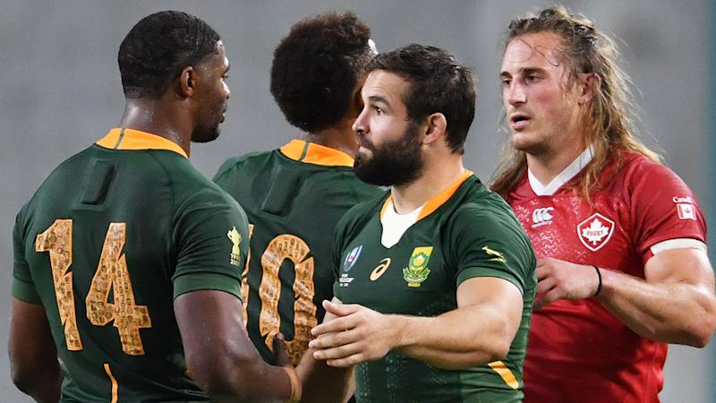 South Africa and Canada players, pictured here after their clash at the Rugby World Cup.