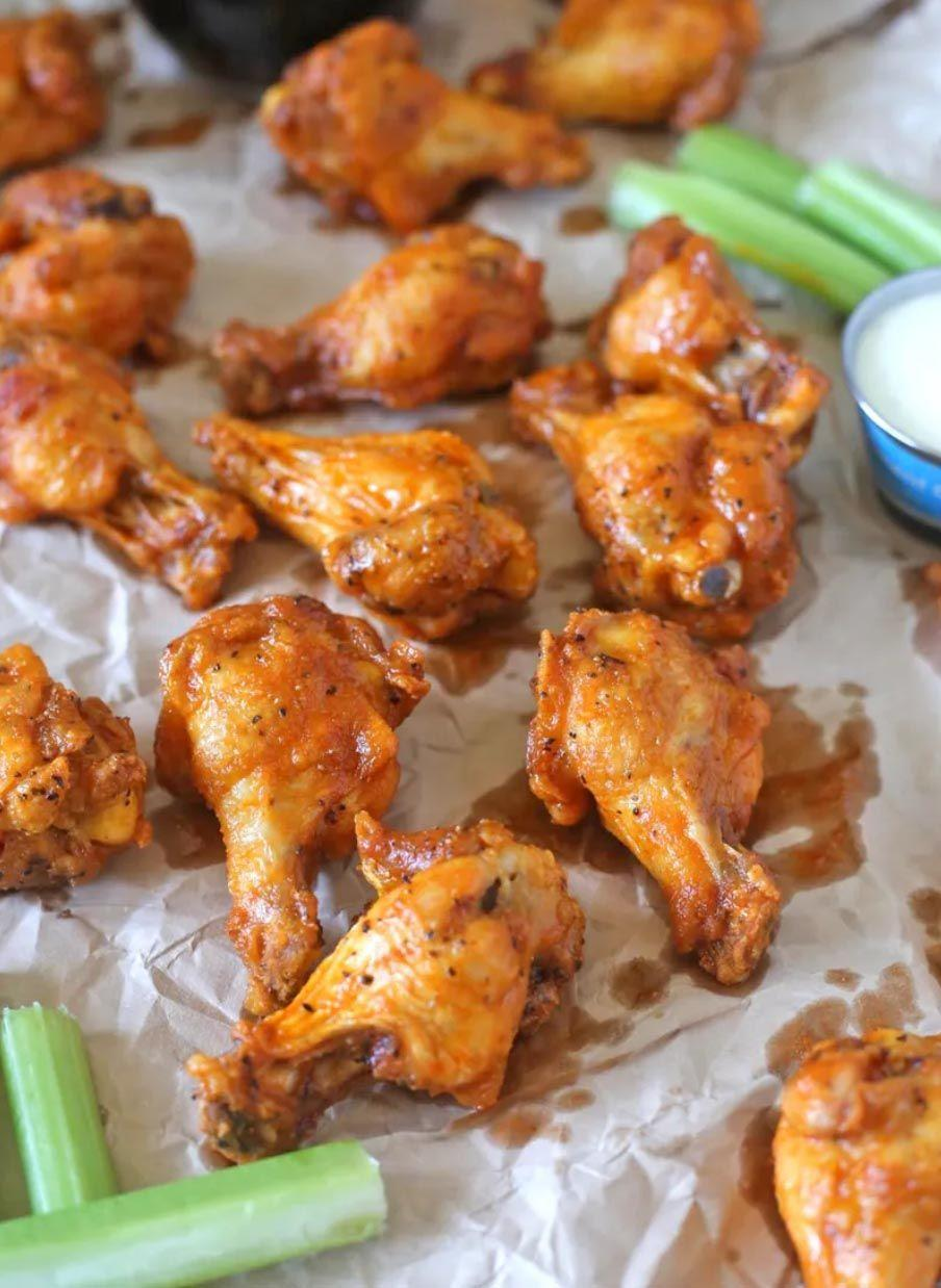 """<p>Toss fried wings in a spicy homemade buffalo sauce for a snack or meal (pair it with a crispy green salad) that the whole family is sure to gobble up!<strong><br><br></strong></p><p><strong>Get the recipe at <a href=""""https://bsugarmama.com/easy-buffalo-chicken-wings/"""" rel=""""nofollow noopener"""" target=""""_blank"""" data-ylk=""""slk:Brown Sugar"""" class=""""link rapid-noclick-resp"""">Brown Sugar</a>.</strong></p>"""