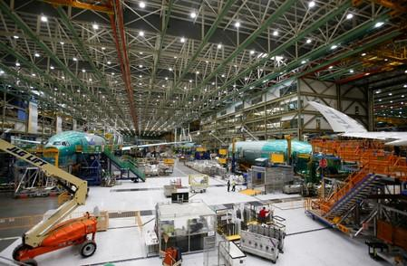 Several Boeing 777X aircraft are seen in various stages of production during a media tour of the Boeing 777X at the Boeing production facility in Everett,