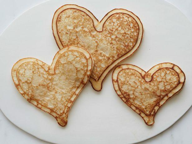 <p>These heart-shaped hotcakes take breakfast in bed to a new level. Think of a squeeze bottle filled with batter as your kitchen paintbrush: Squirt a heart outline on a hot griddle, let it start to set, and then flood it with more batter for charming less-than-perfect hotcakes.</p>
