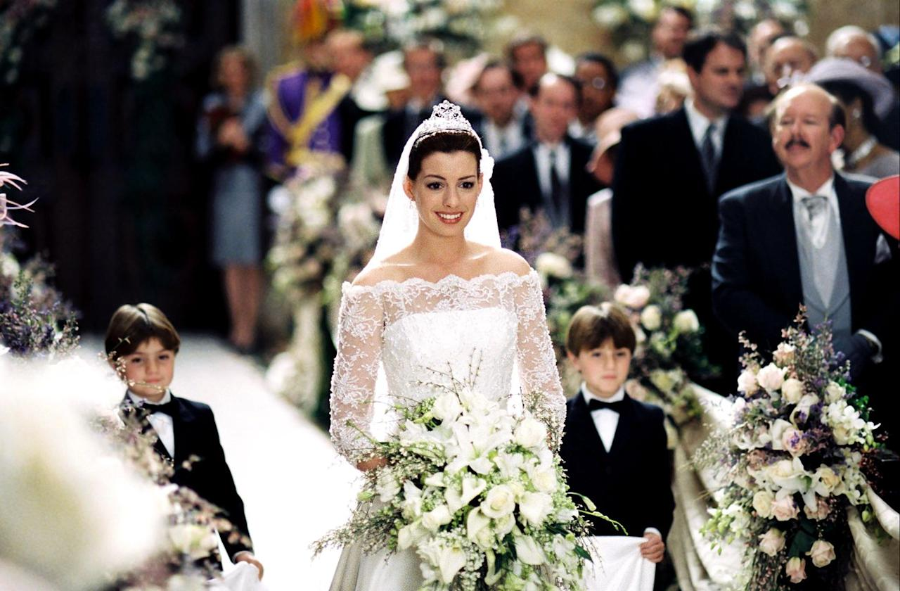 """<p>In this sequel, Mia Thermopolis (Anne Hathaway) must find a suitor in order to become queen. She chooses Andrew Jacoby, Duke of Kenilworth, (Callum Blue) and prepares to marry him even though they don't love each other. Mia calls off the wedding at the altar, much to Andrew's relief too. It was a sad but beautiful moment made all the more stunning by Mia's off-the-shoulder lace gown-certainly <a rel=""""nofollow"""" href=""""https://www.marieclaire.com/culture/g14448603/royal-wedding-dresses-through-the-years/"""">fit for royalty</a>-which was created by costume designer Gary Jones.</p>"""