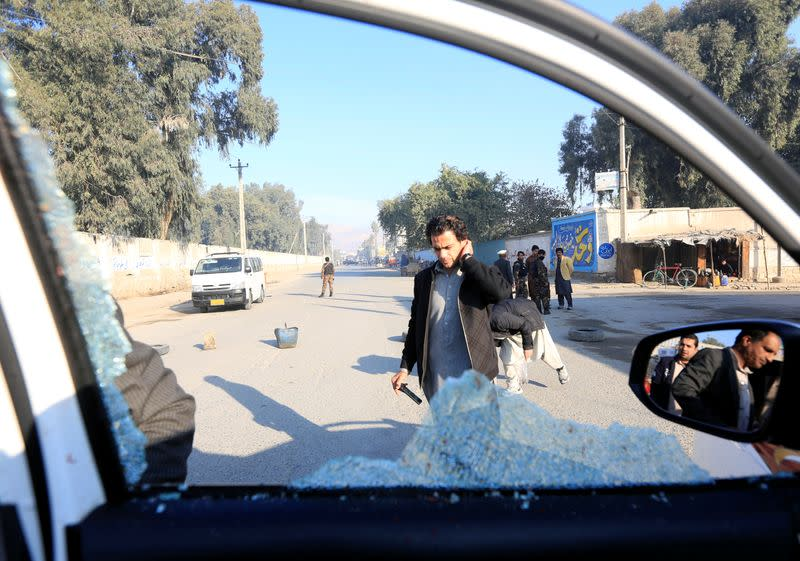 A broken window of the vehicle that was carrying Japanese doctor Tetsu Nakamura during the attack is seen in Jalalabad