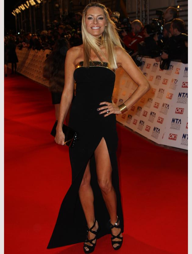National TV Awards 2012 photos: Tess Daly showed off her slim stems in a strapless black dress with a thigh-high split. She accented her look with a gold trim and cuff.