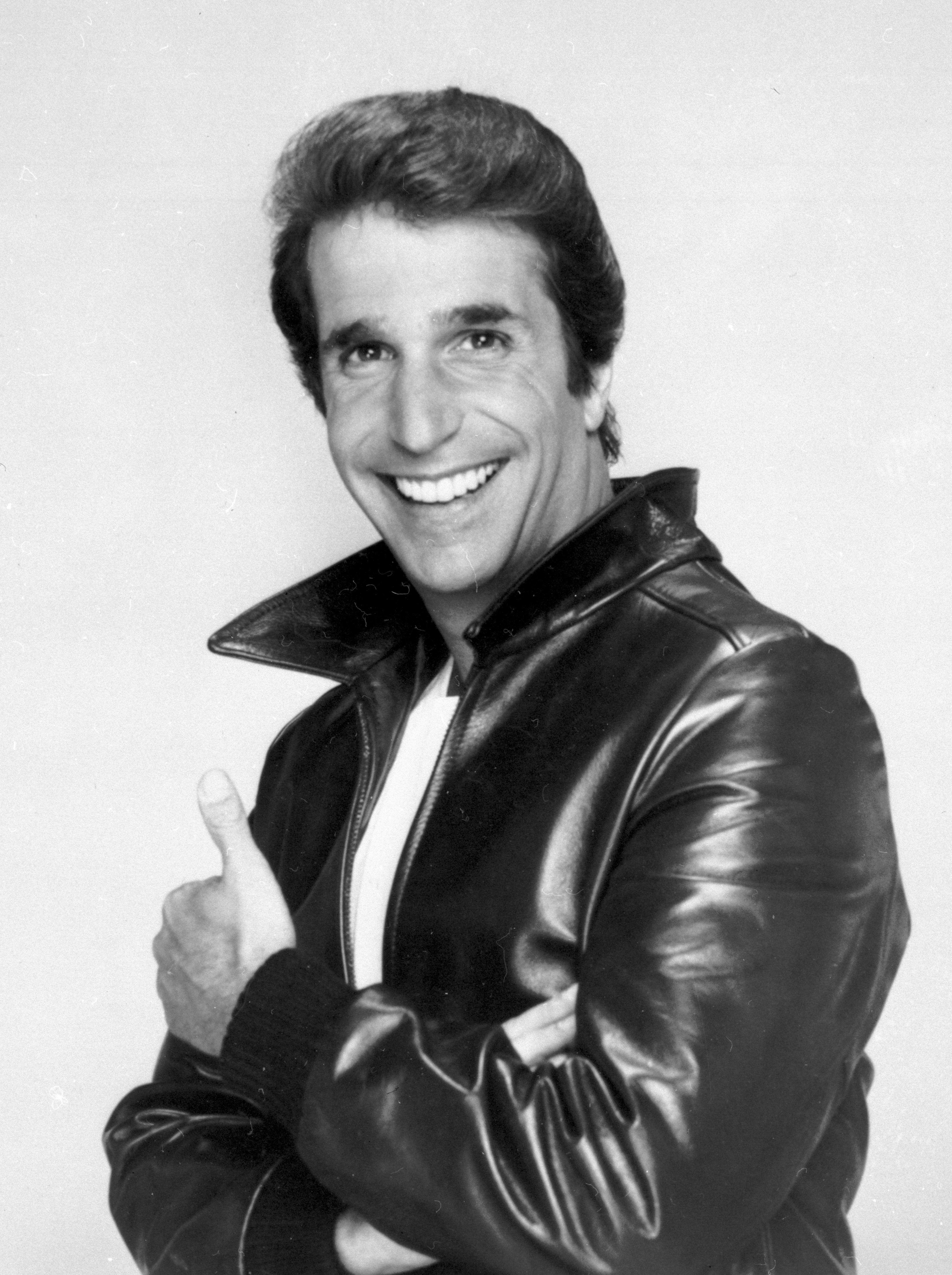 """FILE-This file photo from 1984 shows Henry Winkler as """"The Fonz"""". If your TV has hovered even a second on MTV these past few weeks, you've most likely caught the men of the reality show """"Jersey Shore"""" pimping their version of extreme masculinity: big muscles, big tans and big fights. The fellas, all tied together by their Italian-American ancestry, try to pass themselves off as this decade's answer to the Italian stallion. But really, how do they measure up to TV's ultimate Italian lover, Arthur """"The Fonz"""" Fonzarelli of """"Happy Days""""? (AP Photo/File)"""