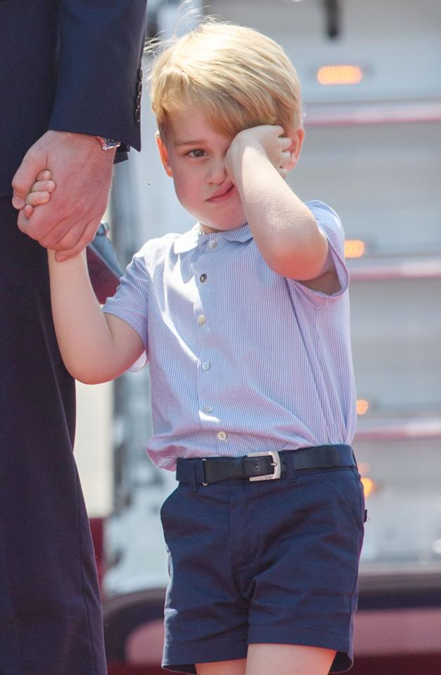 <p>I'm tired! Prince George can't hide his fatigue during the Duke and Duchess of Cambridge's trip to Berlin. (Rex) </p>