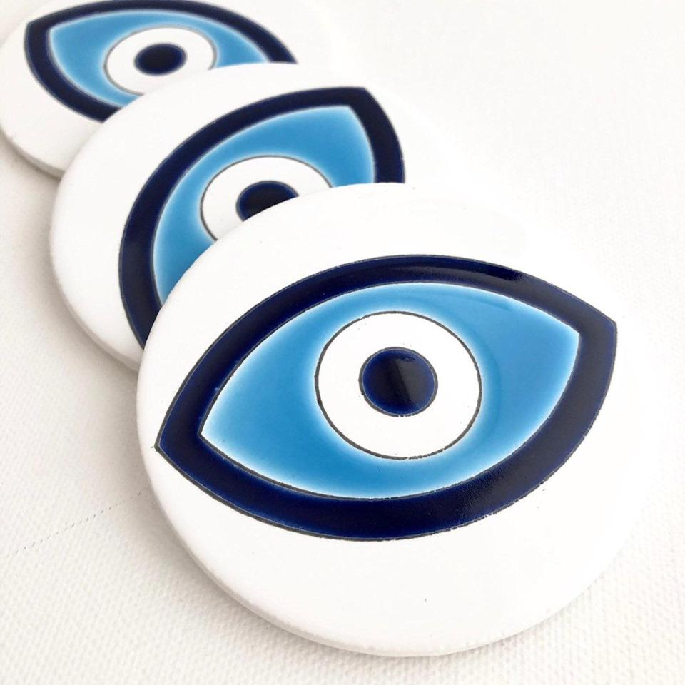 "<br> <br> <strong>NAEGEA</strong> Evil Eye Coasters, Set of 3, $, available at <a href=""https://go.skimresources.com/?id=30283X879131&url=https%3A%2F%2Fwww.etsy.com%2Flisting%2F709876410%2Fevil-eye-coaster-set-drink-holders"" rel=""nofollow noopener"" target=""_blank"" data-ylk=""slk:Etsy"" class=""link rapid-noclick-resp"">Etsy</a>"