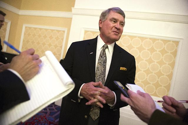 Atlantic Coast Conference Commissioner John Swofford speaks with reporters at the NCAA's Autonomy Business Session during the final day of the NCAA Convention in Oxon Hill, Md., Saturday, Jan. 17, 2015. The five most powerful and wealthiest conferences in college sports passed NCAA legislation that increases the value of an athletic scholarship by several thousand dollars to cover the federally determined actual cost of attendance. (AP Photo/Cliff Owen)