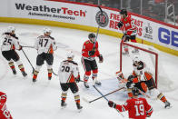 Chicago Blackhawks left wing Dominik Kubalik (8) raises his stick after scoring against the Anaheim Ducks during the second period of an NHL hockey game Saturday, Jan. 11, 2020, in Chicago. (AP Photo/Kamil Krzaczynski)