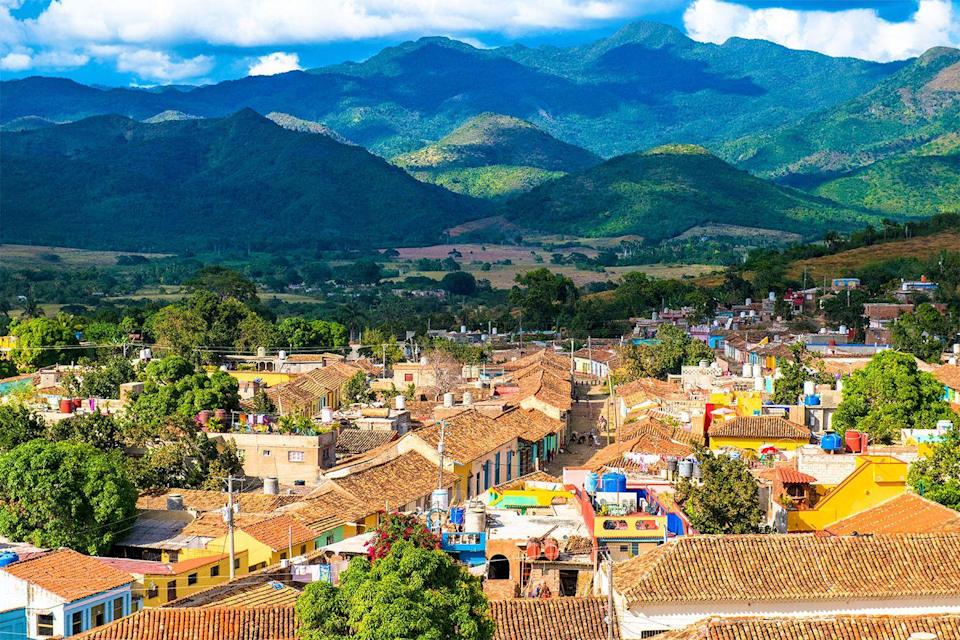 <p>Colorful houses stand in a valley below the Escambray mountains of Trinidad, Cuba // Date unknown</p>